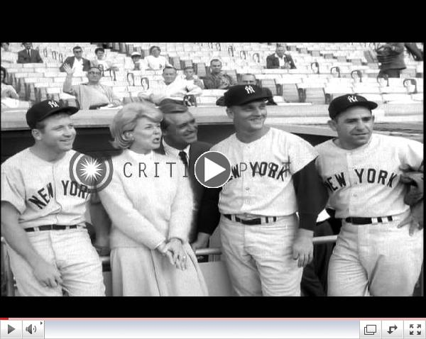 Doris Day and Cary Grant with Baseball players to promote their film
