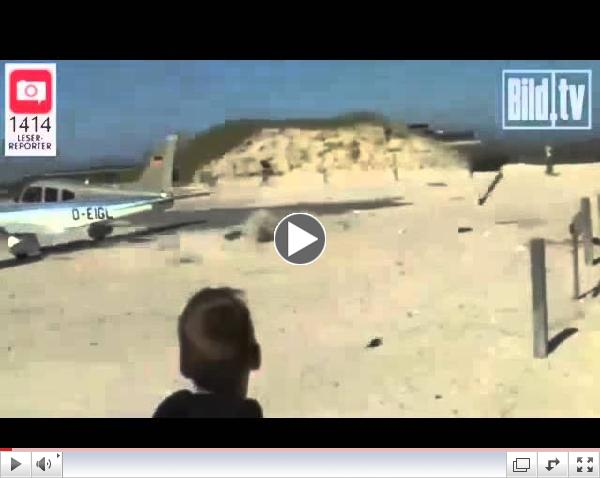 9RAW: Small plane almost lands on sunbather