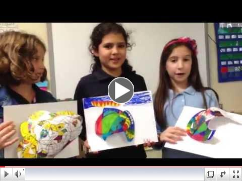 Third graders explaie their art projects. See all the projects on our Facebook page.