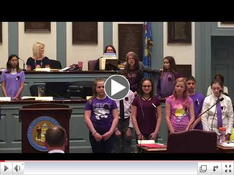 Dover Air Force Base Middle School's choir sings Song of Peace in the Delaware Senate as part of the April 2018 Month of the Military Child celebration.