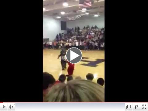 Mascots from Louisville Male and duPont Manual high schools fight during basketball game