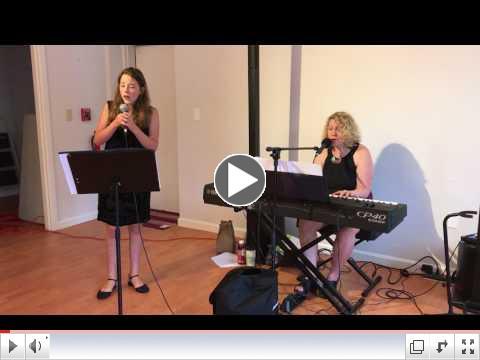 Linda Marks and Abigail Arndt sing