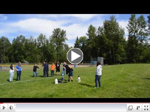 Students at Maple View Middle School test their 2-liter bottle rockets.