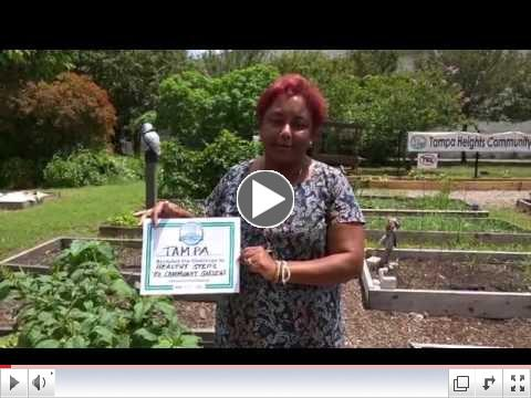 Michele Ogilvie, Garden Steps project manager accepts the challenge on behelf of the Hillsborough MPO
