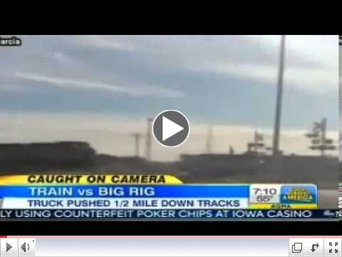 Train Crashes into Semi Truck VIDEO Train Crashes Into Semi Stuck on Tracks