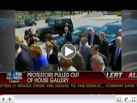 Nancy Pelosi walks past protestors with big gavel.mov