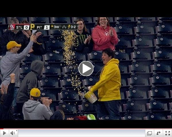 A fan uses a tub of popcorn to make a catch