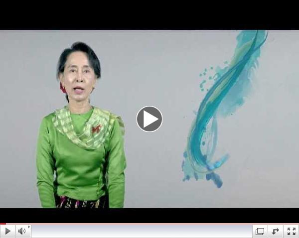 �varp N�belsver�launahafans Daw Aung San Suu Kyi vi� upphaf herfer�arinnar gegn mismunun.