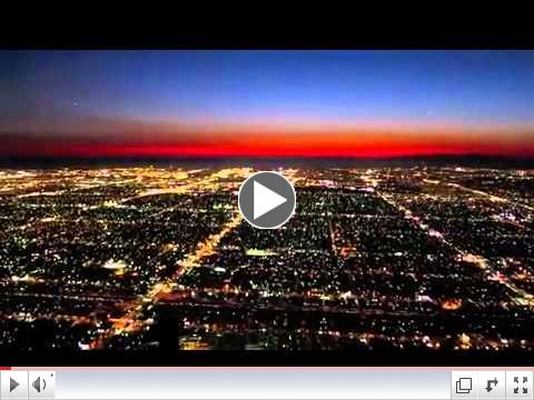 Cockpit view of a twilight landing at LAX