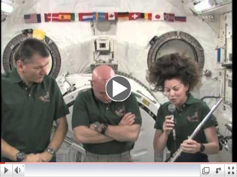 Astronaut Cady Coleman plays flute on space station