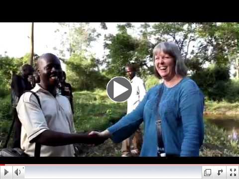 How Ugandans shake hands
