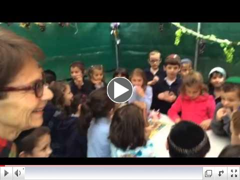 Hillel Academy first graders went to Beacon Place to sing and bring Sukkot decorations.